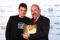 Ian picks up his award from singer Matt Willis