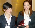 Marie Morton and Amy Woolfson with the winners' trophy
